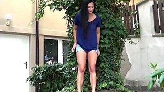 Torrid raven haired hooker pisses in neighbor's garden