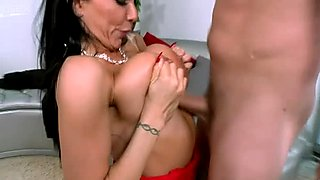 Stacked black haired hottie presents solid boob fuck to her young boy
