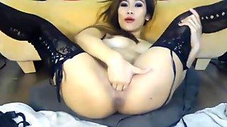 Chinese babe Akeisha fisting pussy